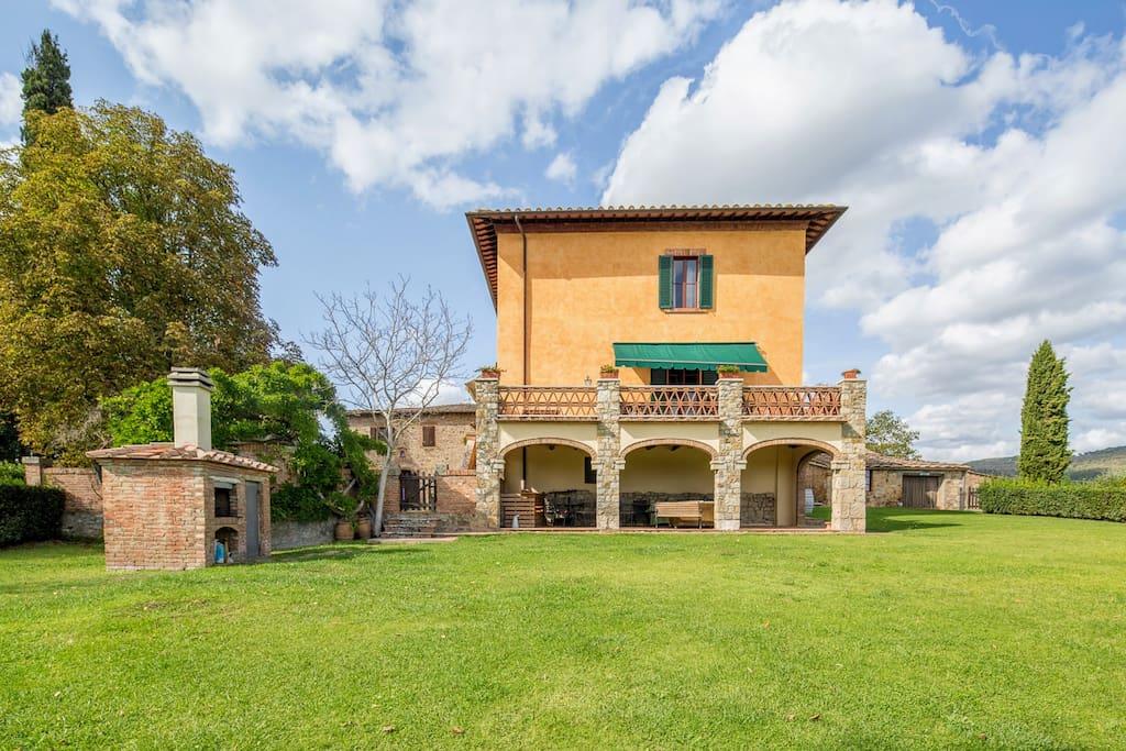 villa exterior, with loggia and barbecue