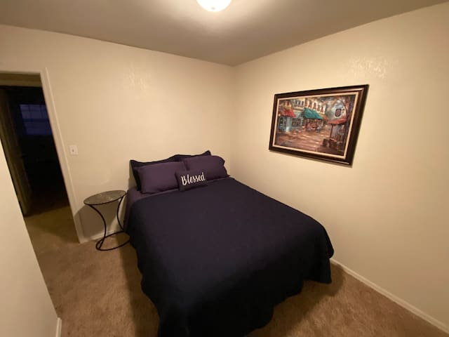 Queen bed. New mattress and linens.