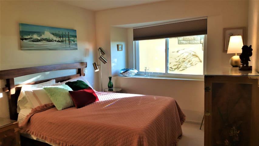 Guestroom 2. Queen bed. Garden views and peeks of the bay.