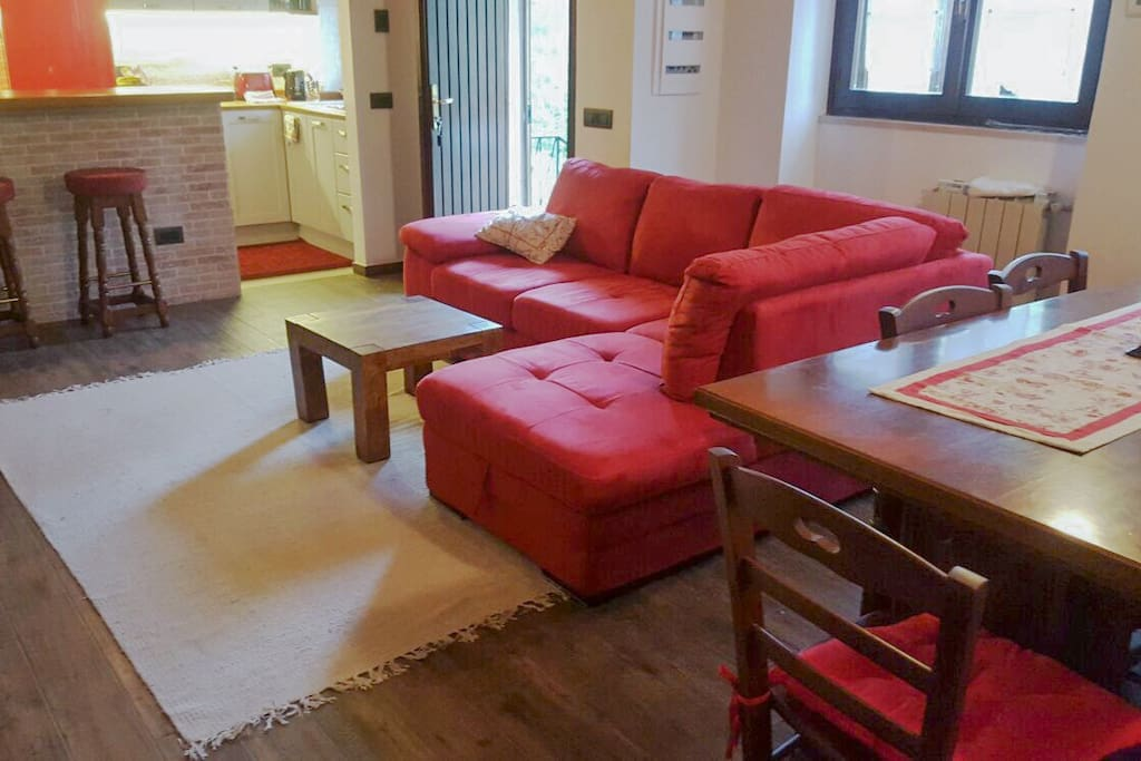 Front room, sofa bed, large dinner table