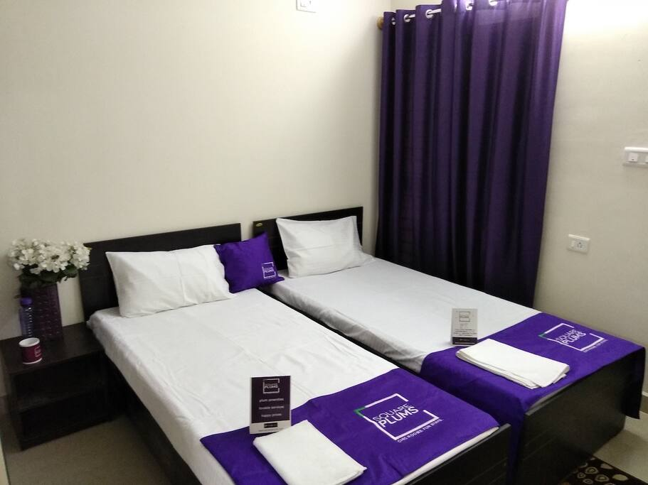 Bedroom with 2 single beds, wardrobes, private bathroom