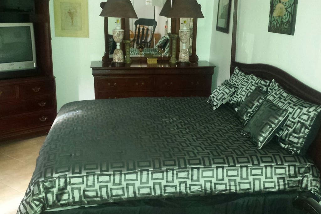 California King size bed, dresser, and tv