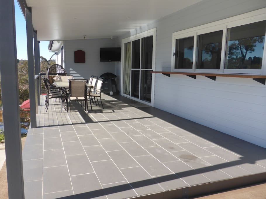 Large north facing outdoor entertaining area with TV, BBQ and dart board