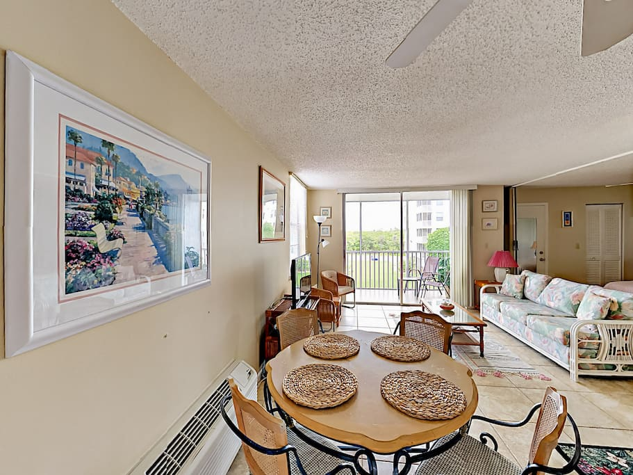 Step out on the balcony through the sliding glass doors.