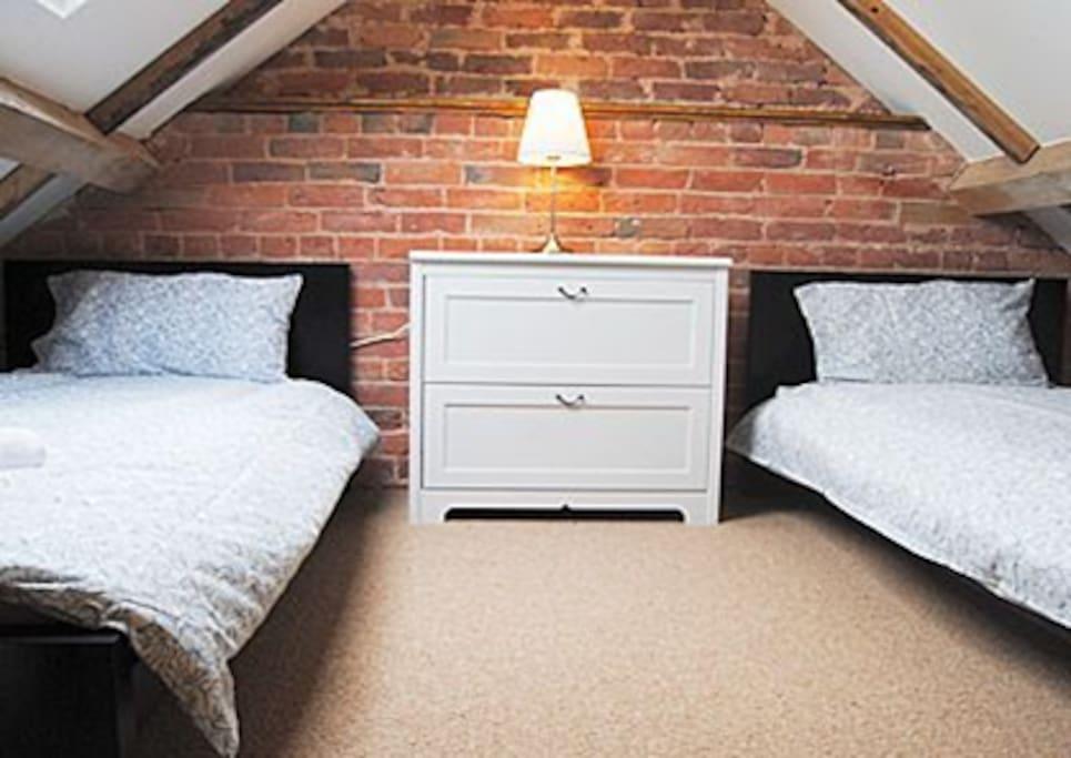 mezzanine single beds