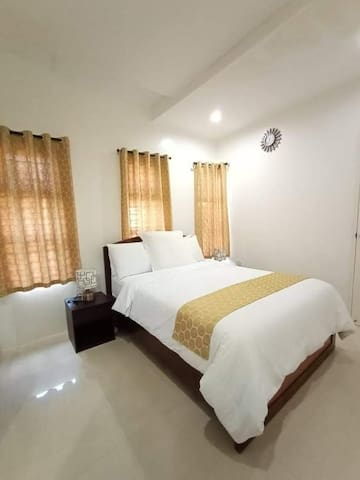 One of the 3 bedrooms  ( 2 bedrooms are identical)  with ensuite and aircondioned .