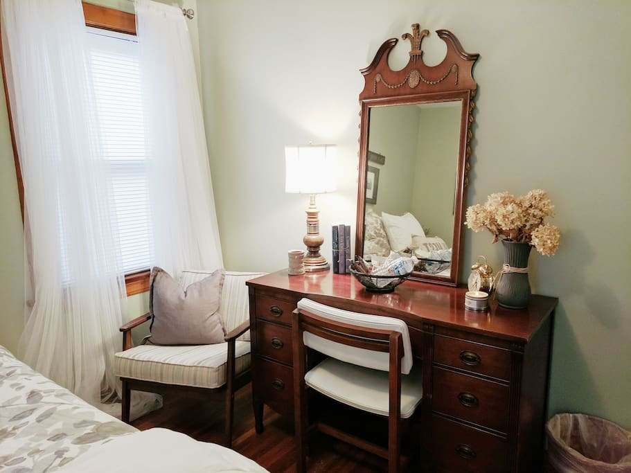 Plenty of work space and a comfy chair is provided in your room