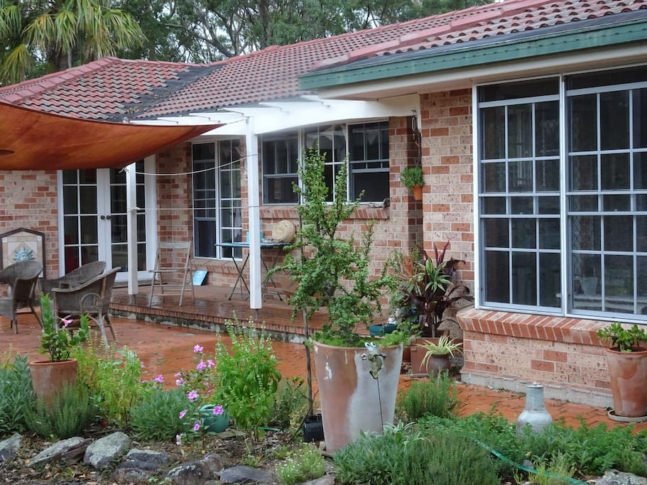 Gorgeous established gardens surround the home.