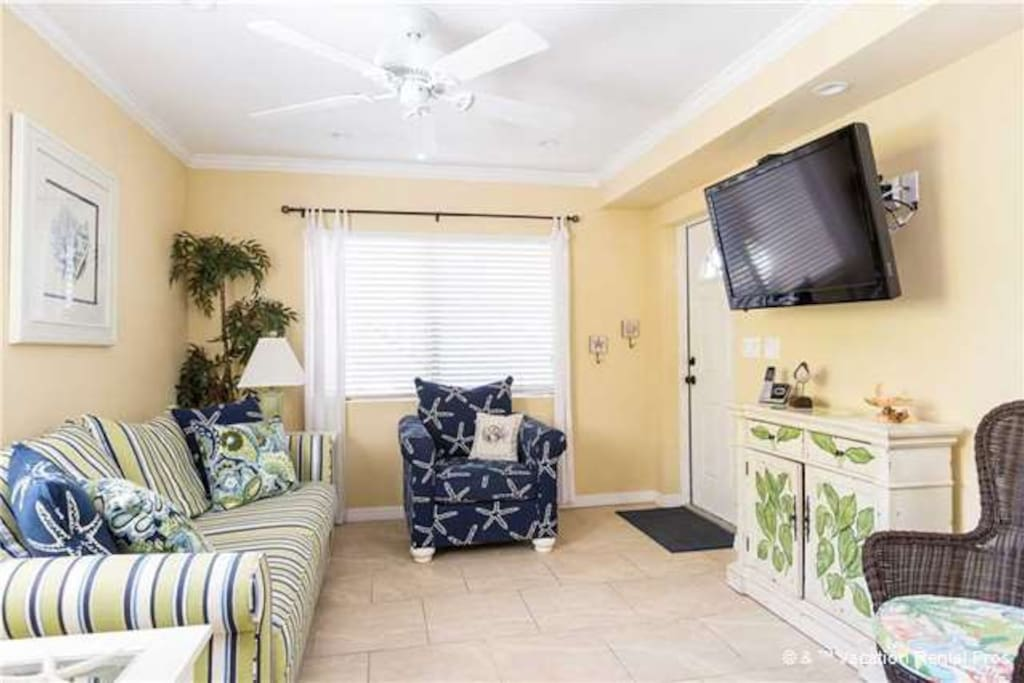 Living room with queen sofa bed and flat panel TV