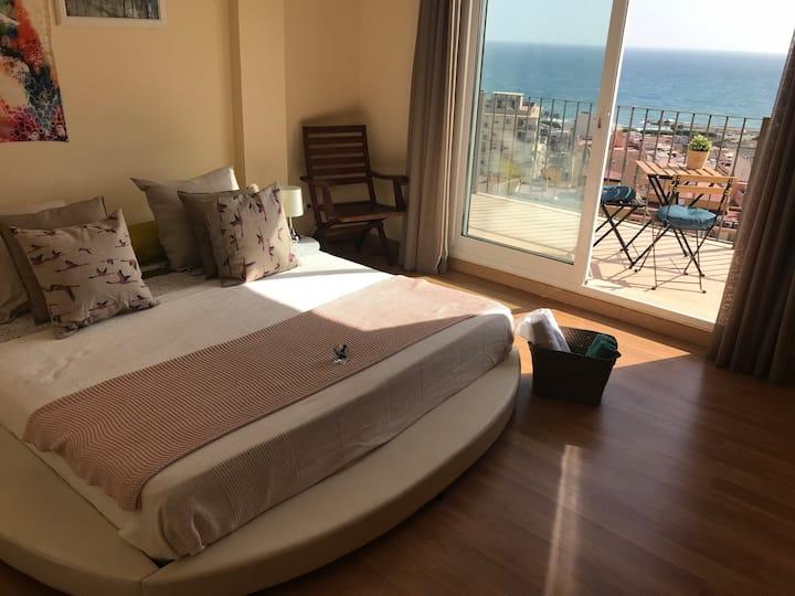 Habitación cama King en chalet frente al mar
