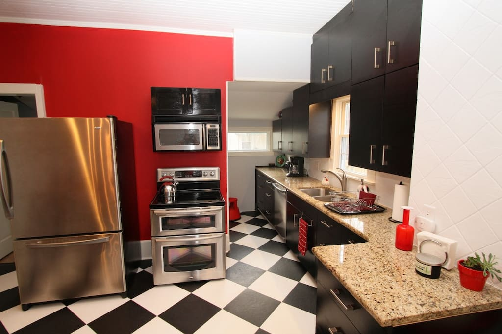 Kitchen is fully equipped, including a dishwasher and washer and dryer.