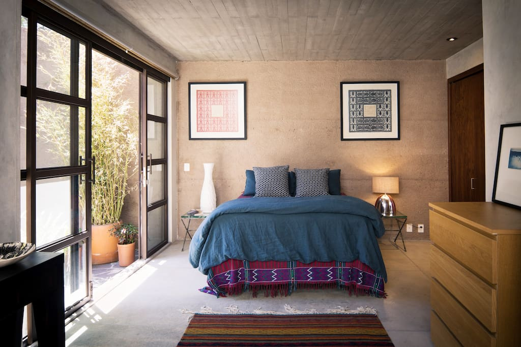 Master bedroom opens to a small private patio and outdoor shower.
