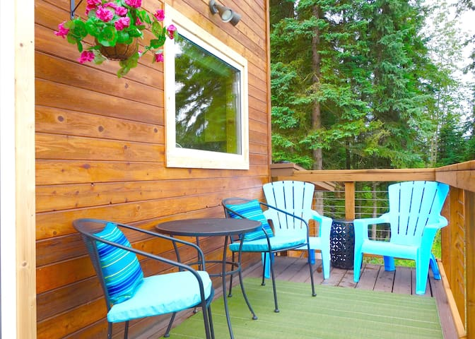 These seats on the front deck are great for viewing the dog team that passes by the cabin May - September