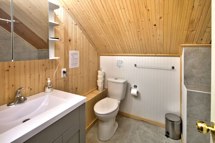 One of three bathrooms with bath tub and shower