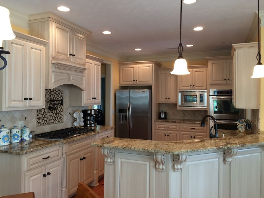 Custom kitchen with double ovens and upgraded appliances.