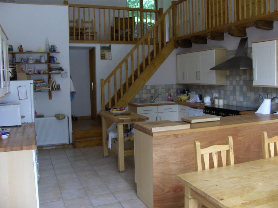 Very large kitchen with dining table.