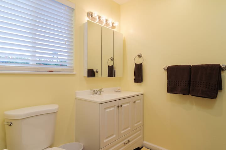Bathroom is bright and includes soap, shampoo, conditioner, hair dryer and full linens.