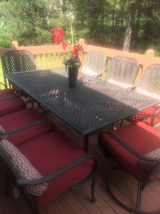 Outdoor deck ready for summer fun with gas grill and patio set