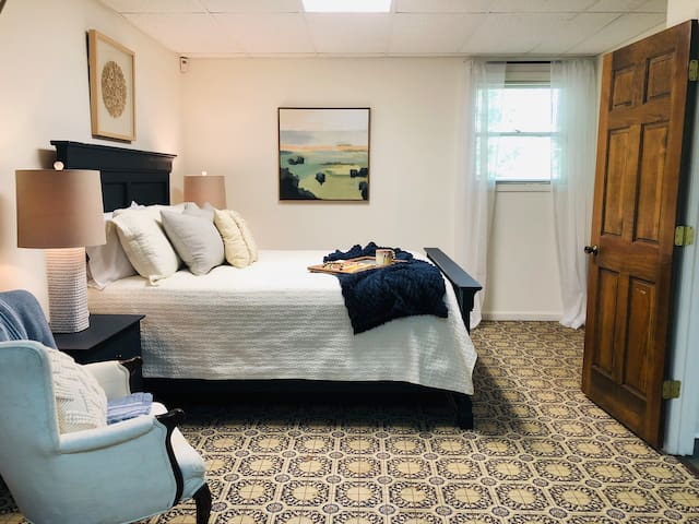 This is a very large room that's separated by curtains to make it feel like two rooms. This side has a queen bed and closet with extra blankets, a fan, and a heater.