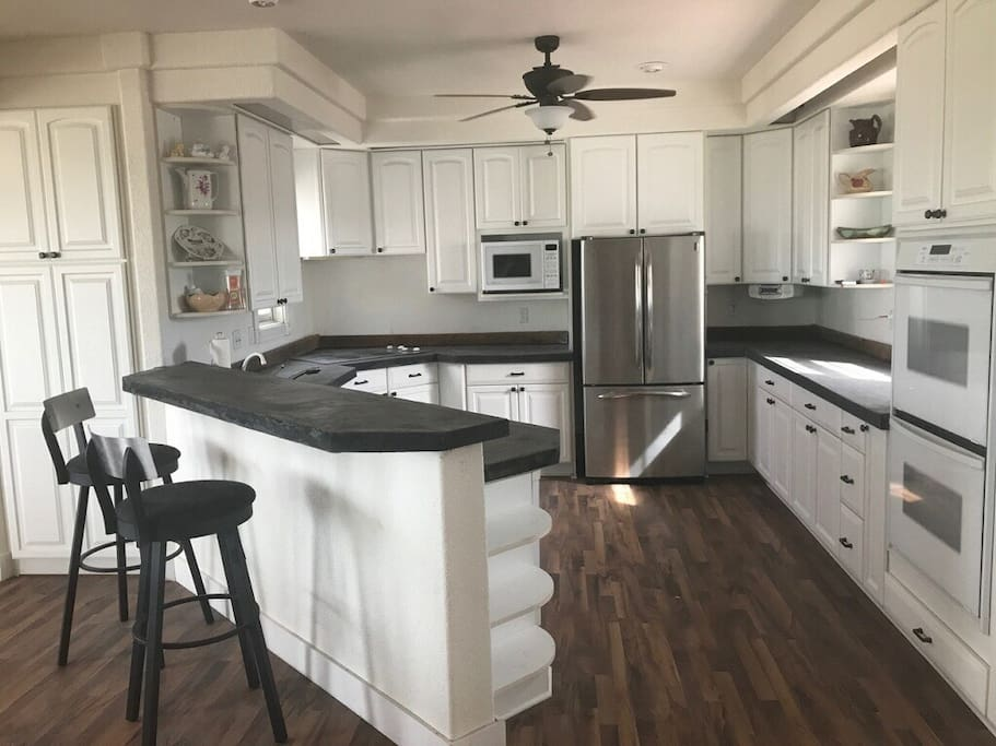 Brand new concrete counters, new floors, sink and refrigerator. Double oven. Comes stocked w plates/bowls, cups, silverware, pots/pans, etc.