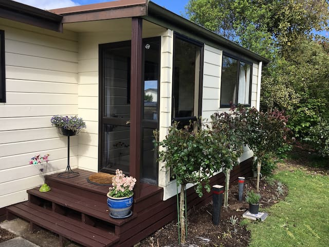 Serendipity Cottage. Nestled in native trees. Wake up to bird song.  Short stroll to New Zealand's largest lake.