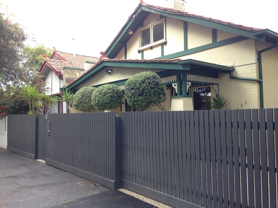 Front of house with new high security fence.
