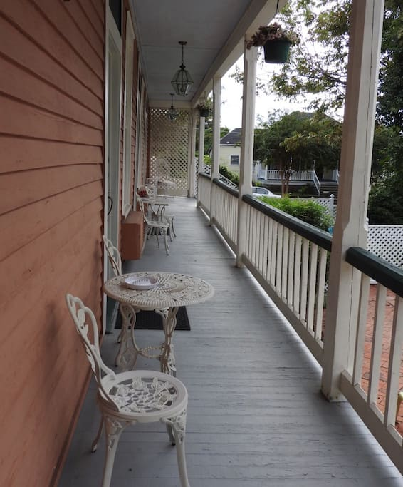 Porch overlooking pool with glimpses of Mississippi River