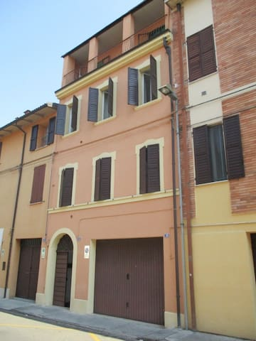 Our flat is on the 2nd floor, the one with the open shutters