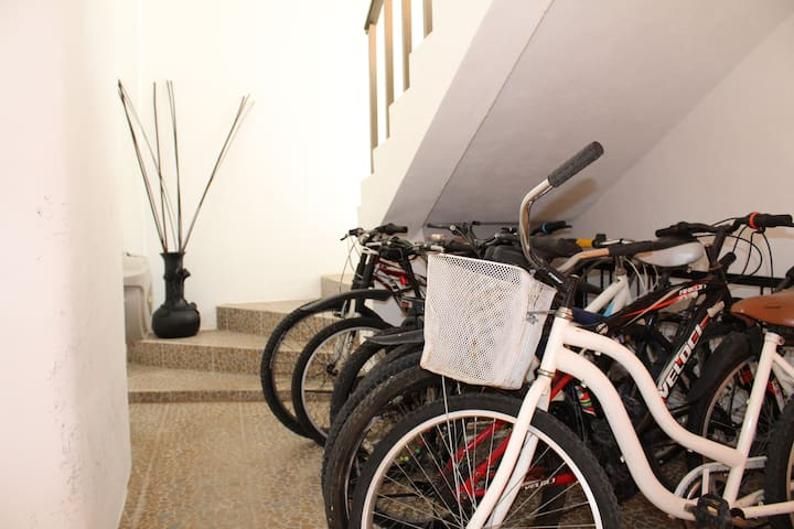 Bike area showing stairs to go to roof top.