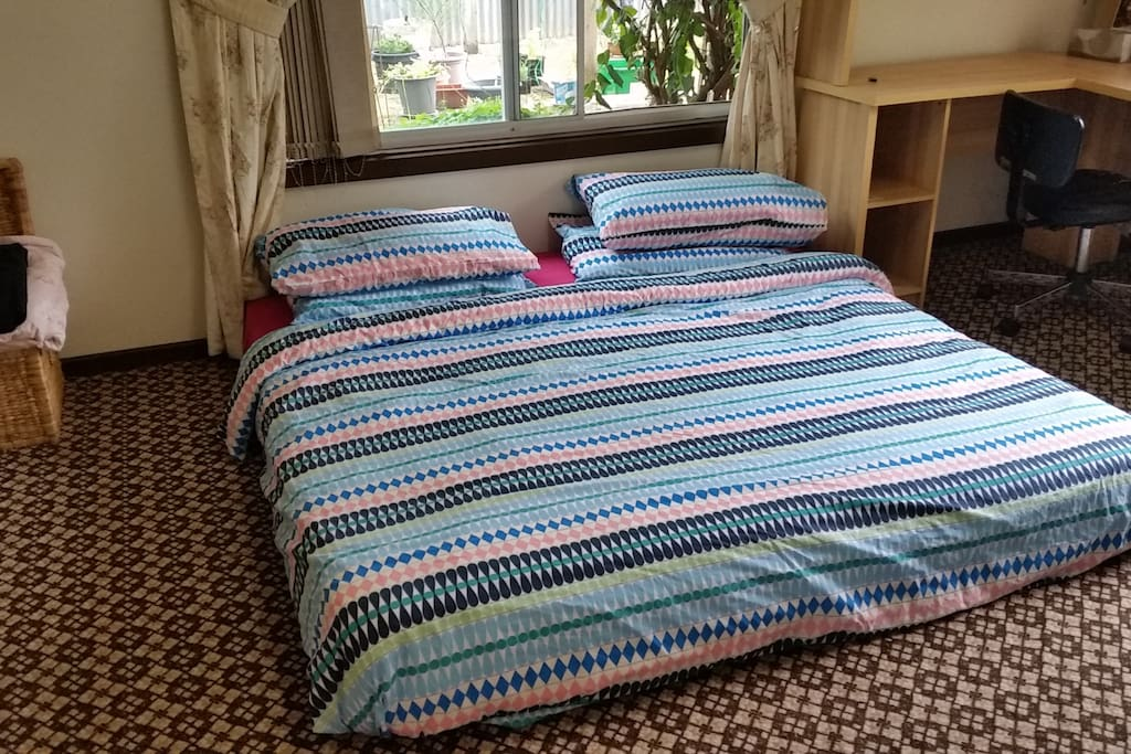 Large king sized bed. Note that this bed can also be separated into 2 single beds. Individual linens are also provided.
