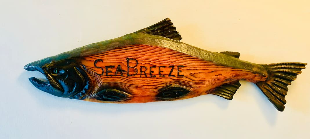 Holding the name to this vacation rental is a masterfully carved salmon made by a local artist.