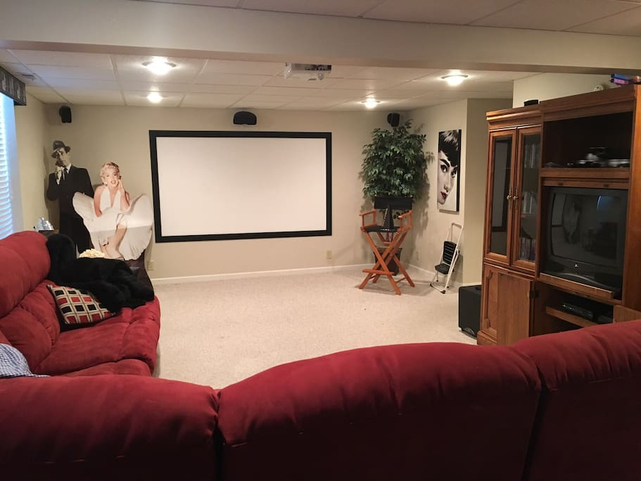 Basement video room with recliner chairs and a sleeper couch