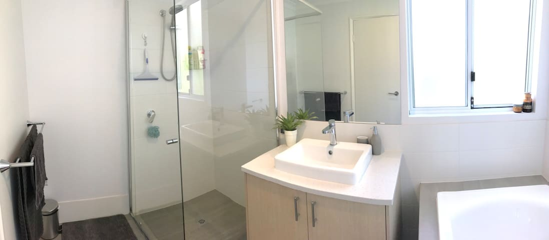 Second bathroom with bath