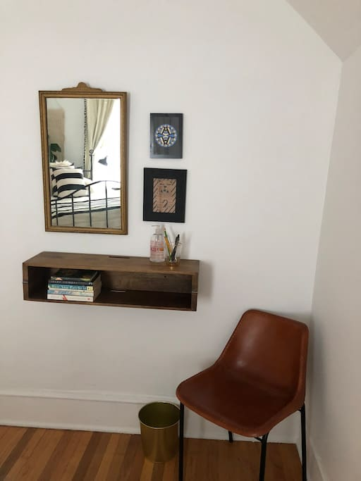Shelf that converts to desk so you can do work in master bedroom.