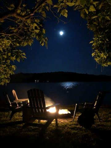 Summer campfires under the moon