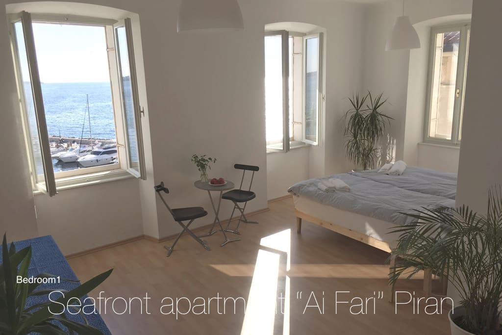 Bedroom 1 with windows facing the Adriatic Sea.
