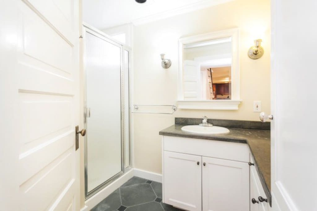 Private bathroom with shower and toiletries