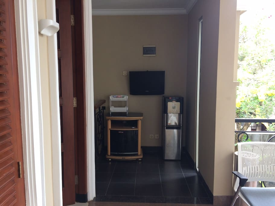 Tv and dispenser are outside the rooms