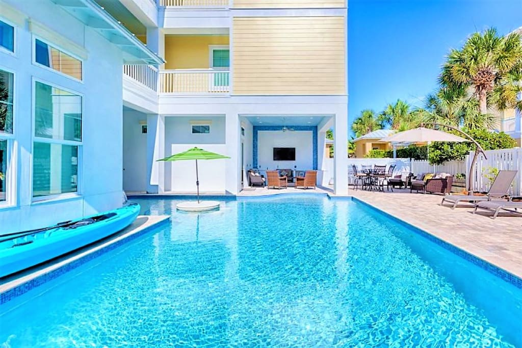 Born To Sun features a Large Private Pool and Spa with Plenty of Lounge Chairs and a Summer Kitchen