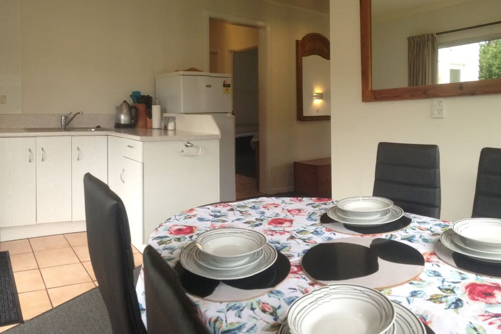 The Flat kitchen-dining area is open-plan, and the dining table can extend to seat up to 7.