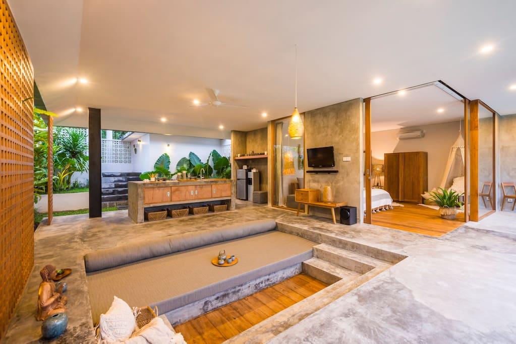 Spacious living room with sunken sofa