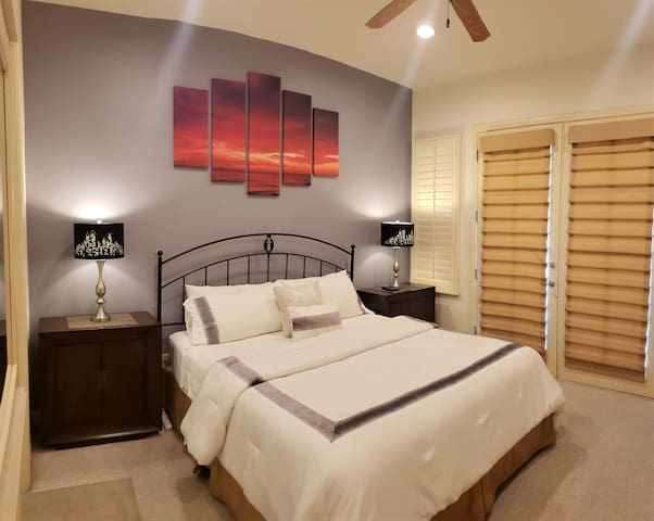 13. Master Bedroom with King Bed, Flatscreen TV, attached patio overlooking lush garden. Private bathroom with soaking tub.