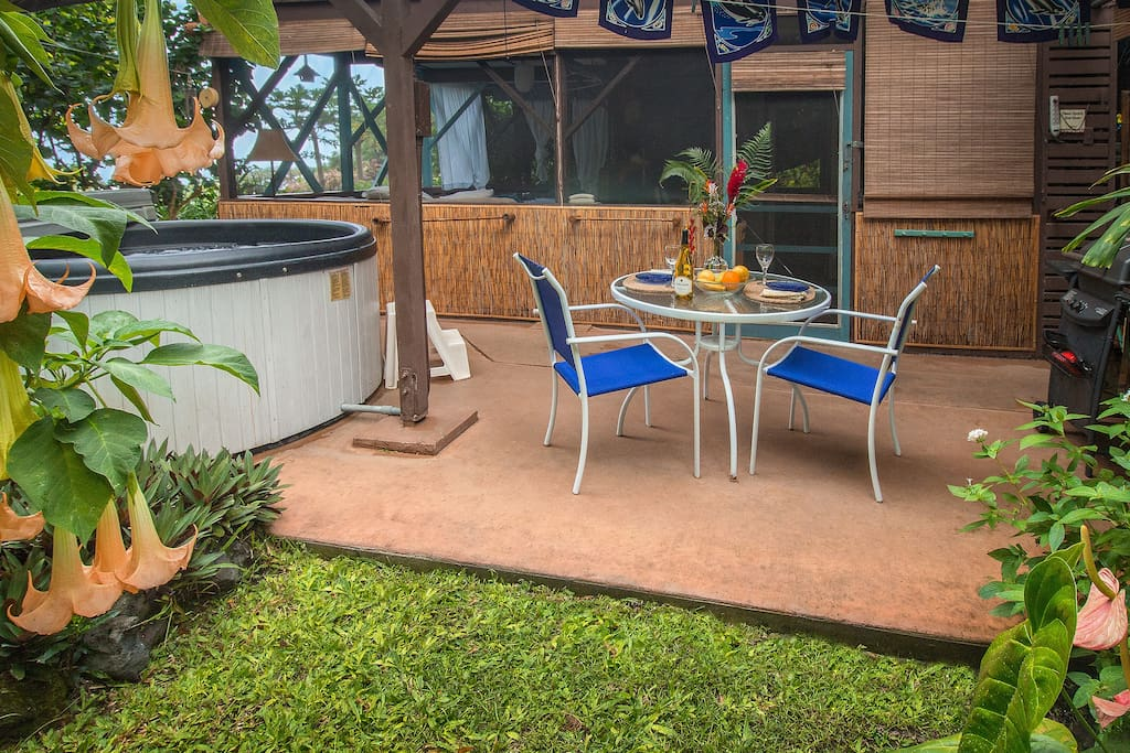 Patio with private hot tub, outdoor dining, gas-fired BBQ grill, and yard