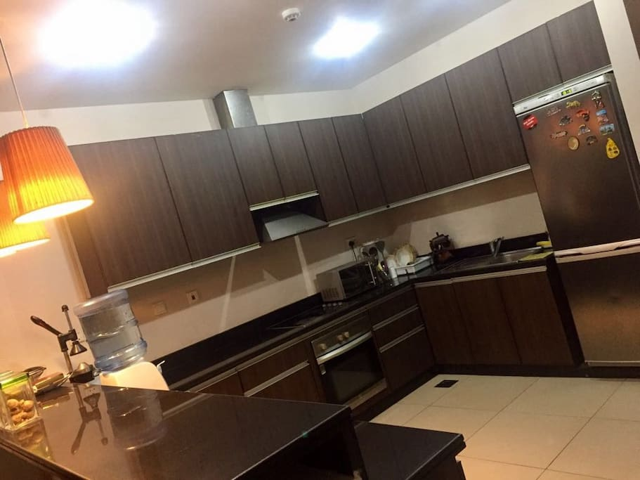 Big Open Kitchen with Oven, Microwave, Fridge and Juicer.