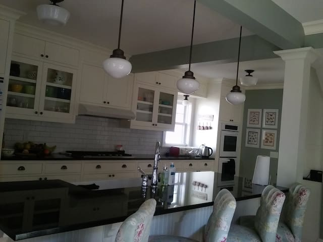 Gourmet / entertainer's dream kitchen. Gas 5 burner with high BTU, double electric wall ovens.