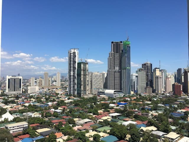 Serene Makati Aerie with Pools, Gardens, and Mall