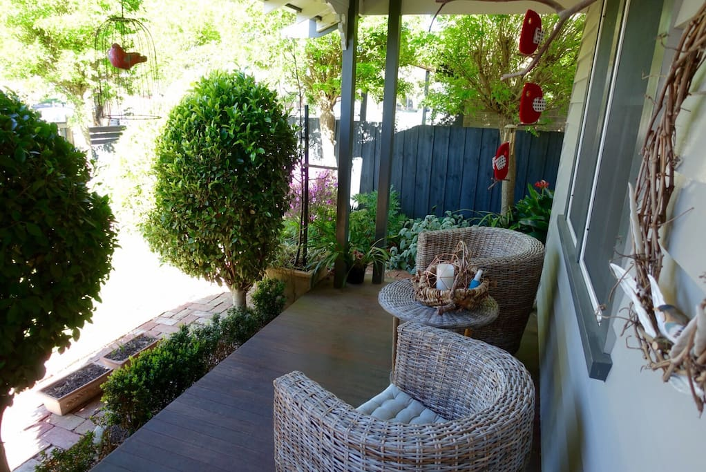 Front covered deck with beautiful garden setting