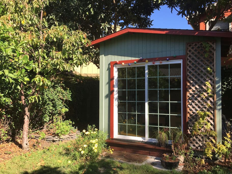 Garden cottage surrounded by fruit trees