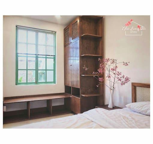 Bedroom 2 with 1 queen bed, with window overlooking the lovely garden