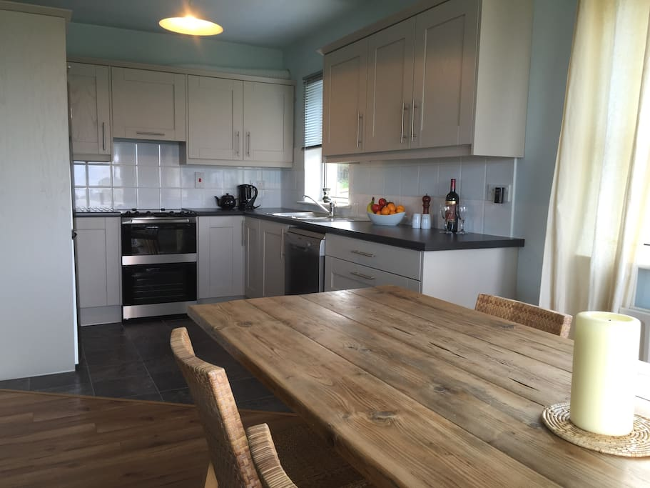 Completely new kitchen and extra long farm dining table.